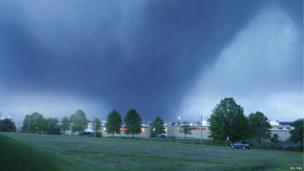 The funnel cloud is pictured from the Barnes Crossing area of Tupelo as the tornado made its way across town on Tupelo, Mississippi on 28 April 2014.