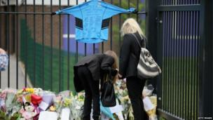 Schoolchildren arrive at Corpus Christi Catholic College in Neville Road on April 29, 2014 in Leeds, England.