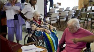 Elderly South African voters, assisted by nurses, cast their ballots during early voting for special groups at the Nazareth House old-age home in Johannesburg, South Africa