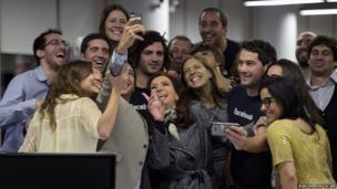 Argentine President Cristina Fernandez de Kirchner (centre) poses for a selfie with workers of Facebook Argentina