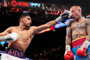 Amir Khan (left) of Britain punches Luis Collazo of the US during their welterweight fight at the MGM Grand Garden Arena in Las Vegas, Nevada