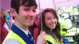 Two School Reporters under a pink umbrella