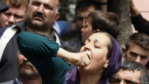A relative of a miner reacts as she waits in front of an hospital in Soma, a district in Turkey's western province of Manisa May 14