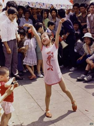 A young girl dances in Tiananmen Square on 1 June 1989
