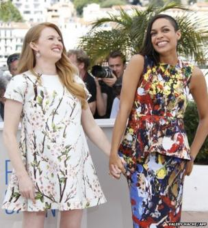 US actresses Mireille Enos (left) and Rosario Dawson pose during a photocall