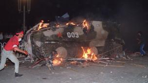 An armoured personnel carrier in flames on 4 June 1989 near Tiananmen Square