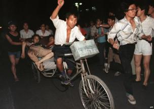 This photo, dated 4 June 1989, shows two injured people being transported during the clash between the army and students near Tiananmen Square.