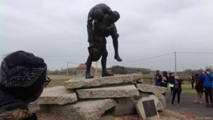 School Reporters Brithany observes a World War One statue at Lyssenthoek Cemetery