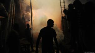Workers from Haiti's Ministry of Public Health and Population spray