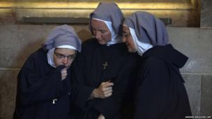 Nuns listen as Pope Francis delivers his speech during a meeting with prelates, nuns and seminarists at the Church of All Nations in east Jerusalem.