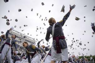 Graduate throw their hats in the air at the United States Military Academy at West Point, New York