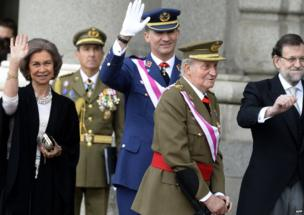 Spain's Queen Sofia (L) and Spain's Crown Prince Felipe (2ndL) and Spanish Prime Minister Mariano Rajoy (R) wave past Spain's King Juan Carlos during the Pascua Militar ceremony