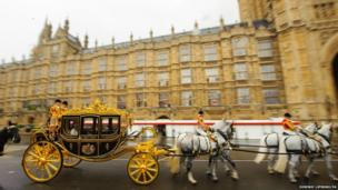 Queen Elizabeth II arrives aboard the new Diamond Jubilee Coach to attend the State Opening of Parliament at the House of Lords