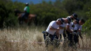 Members of Scotland Yard work at an area during the search for missing British girl Madeleine McCann in Praia da Luz