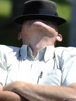A gentleman takes a nap before racing starts
