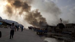Smoke rises above Jinnah International Airport in Karachi, Pakistan where security forces battled militants. 9 June