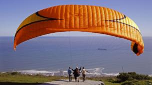 A tandem paragliding flight in Cape Town, South Africa