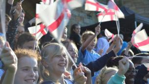 Children wave England flags in Kent