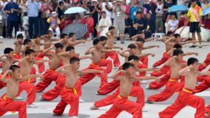 Children perform tai chi during the launch ceremony of the 12th Handan International Tai Chi Conference in Handan, north China's Hebei province, 13 June 2014