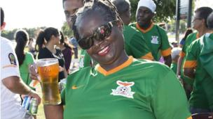 A Zambian football fan with a drink in Tampa, Florida, the US - Friday 6 June 2014