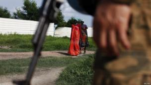 Women walk towards a UN peacekeeper patrolling in Bentiu, Unity State, South Sudan. 18 June June 18, 2014.