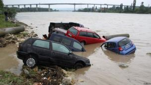 Damaged cars are seen following a heavy flooding in the city of Varna,