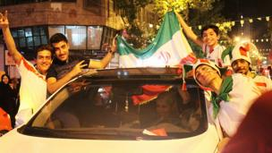 Fans in the Iranian capital, Tehran, celebrate their team's impressive performance in their narrow 1-0 defeat to Argentina