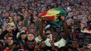 A Ghana fan shows his support during Saturday's game at a public screening in Hamburg, Germany