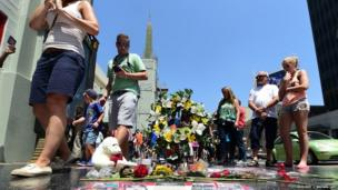 Flowers, candles and a stuffed dolls are among items placed on the late Michael Jackson's Star along Hollywood Boulevard in California