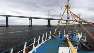 Boat approaching bridge