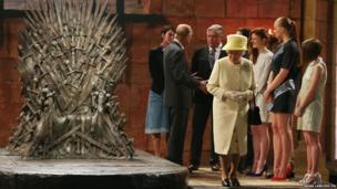 Queen Elizabeth II and the Duke of Edinburgh during a visit to the set of Game of Thrones on day two of a visit to Northern Ireland