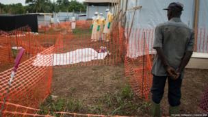 Ebola team near body prepared to show family