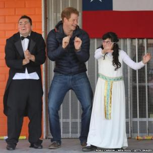 Prince Harry dances with children at the Fundacion Amigos de Jesus day care centre in Santiago, Chile