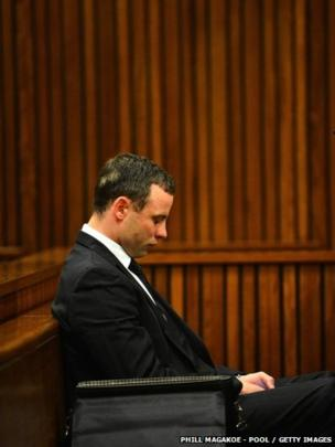 Oscar Pistorius listens to evidence in the Pretoria High Court