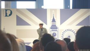 Adam Deacon speaking at the event