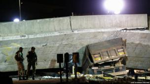 A vehicle is trapped underneath a bridge that collapsed while under construction in Belo Horizonte