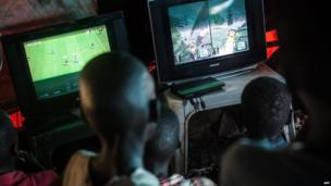 Boys playing video games, Juba, South Sudan - Wednesday 2 July 2014