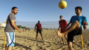 Footvolley players on a beach in Benghazi, Libya - Friday 27 June 2014