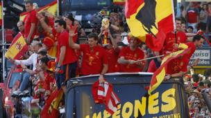 Spain's players celebrate winning the World Cup on their arrival in Madrid in July, 2010.