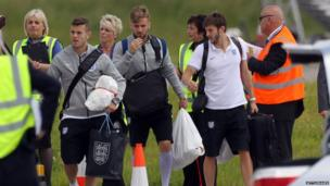 England players arrive back at Luton Airport from Brazil