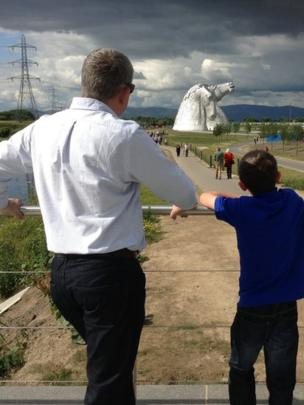 Man and boy looking at The Kelpies