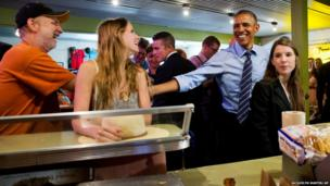 US President Barack Obama jokes with patrons as he orders at Franklin Barbecue in Austin, Texas
