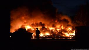 Large quantity of tyres burn at a recycling site in Renfrew, outside Glasgow