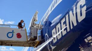 A man enters a Boeing B787-9 aircraft at the Farnborough air show in Hampshire