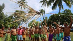 Competitors in a traditional javelin throw at the Heiva Tuaro Maohi sporting event, in Tahiti.