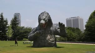 A scaled down model of Godzilla is seen in Tokyo