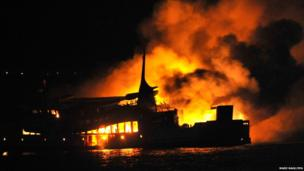 A passenger ferry on fire at Lombok strait, east of Bali, Indonesia