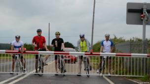 Cyclists at a level crossing