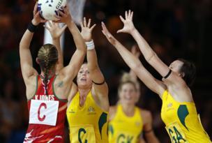 Wales' Kyra Jones is blocked by Australia's Kimberlee Green and Natalie Medhurst during the Australia v Wales netball match