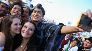 Young people gather for a selfie